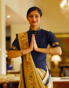 This file is licensed under the Creative Commons Attribution 2.0 Generic license. http://en.wikipedia.org/wiki/File:An_Oberoi_Hotel_employee_doing_Namaste,_New_Delhi.jpg
